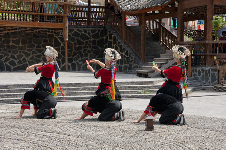 performing: Performing in traditional costume of Miao ethnic Editorial