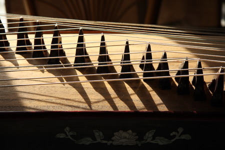 musical instrument parts: Close up of strings on the guzheng