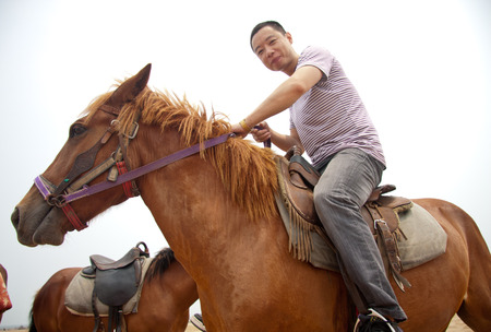 scenic spots: Horse riding at the scenic spots of golden sand beach