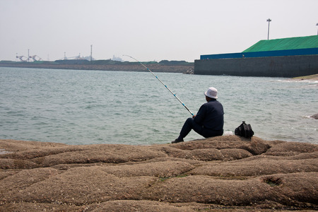 scenic spots: Fishing at the scenic spots of golden sand beach