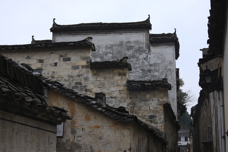stone arches: Xidi built in black marble, two springs through the village and, 99 wall Lane, village has stone arches, old houses in the village as doctor, the unique ancient dwellings embodies the essence of ancient Chinese art. Stock Photo