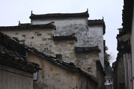 """arcos de piedra: Xidi construido en mármol negro, dos muelles a través de la aldea y, el 99 de pared Lane, pueblo tiene arcos de piedra, casas antiguas en el pueblo como """"doctor"""", las antiguas viviendas únicas encarna la esencia del antiguo arte chino."""