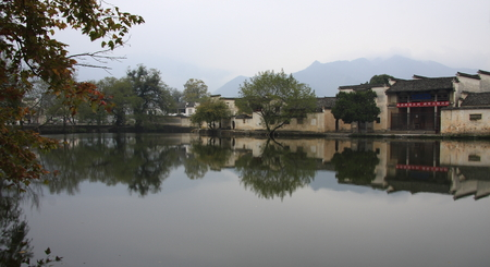 silver maple: Hongcun in Yixian County, Anhui Province, the whole village was built along the mountain with water, it more attractive than other villages of Huizhou architecture known as the painted village. Stock Photo