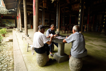 ancestral: Lotus village is located in the rock town, Yongjia County, Zhejiang Province, village clan culture moving charm of architectural arts. In the ancestral temple for the elderly to play cards.