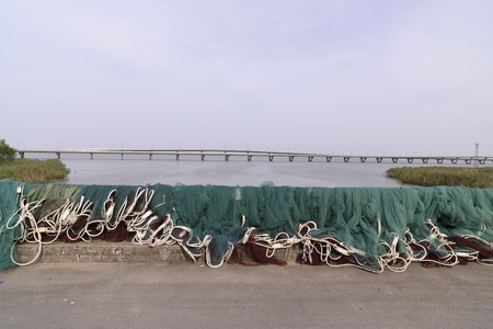 fish net: fishermen on the bridge basking fish net.