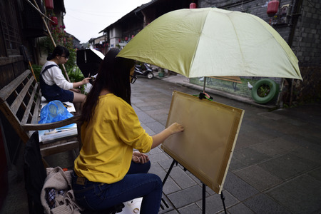 guyan: artist drawing beside of the road