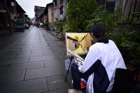 guyan: Artist is drawing beside of the roadside