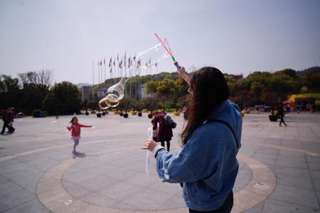 blowing bubbles: Zhejiang huzhou South Tai Lake tourists playing blowing bubbles Editorial