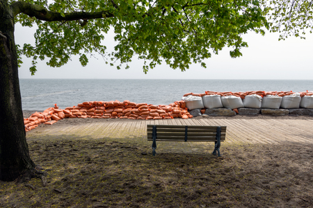Plastic flood protection sandbags stacked into a temporary wall Stock Photo