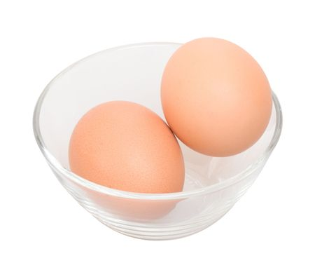 Two eggs in glass bowl isolated on the white background