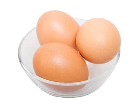 Three raw eggs in glass bowl isolated on the white background photo