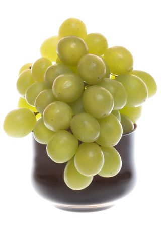 Bunch of green grapes in glass bowl on white background