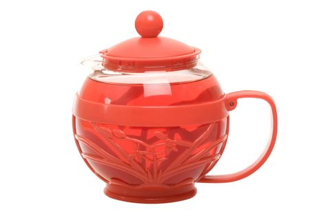 Red herbal tea in red teapot isolated on the white background photo