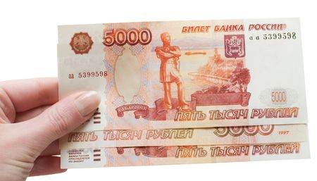 Hand with russian money on the white background Foto de archivo