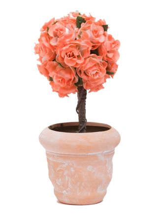 artificial flower in a pot isolated on the white background Foto de archivo