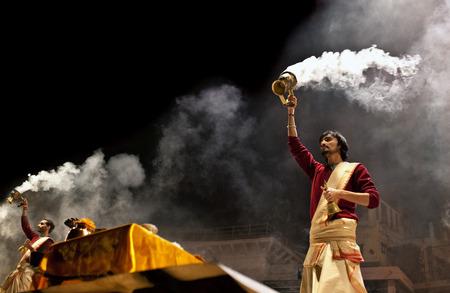 VARANASI INDIA JANUARY 14: Indian Brahmin conducts religious Ganga Maha Aarti ceremony fire puja at Dashashwamedh Ghat on January 14 2010 in Varanasi Uttar Pradesh India. Redakční