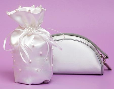cosmetics bag: White cosmetics bag and wedding gift Stock Photo