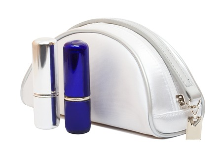 cosmetics bag: White cosmetics bag and two lipsticks isolated on the white background