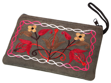 The cosmetic bag with handmade embroidery isolated on the white background