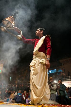 puja: Indian Brahmin conducts religious Ganga Maha Aarti ceremony fire puja at Dashashwamedh Ghat in Varanasi Uttar Pradesh India.