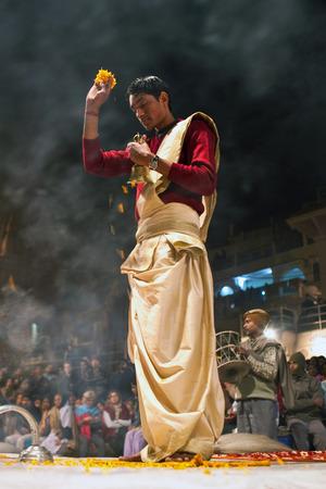 Indian Brahmin conducts religious Ganga Maha Aarti ceremony fire puja at Dashashwamedh Ghat in Varanasi Uttar Pradesh India.