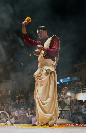 conducts: Indian Brahmin conducts religious Ganga Maha Aarti ceremony fire puja at Dashashwamedh Ghat in Varanasi Uttar Pradesh India.
