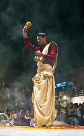 benares: Indian Brahmin conducts religious Ganga Maha Aarti ceremony fire puja at Dashashwamedh Ghat in Varanasi Uttar Pradesh India.