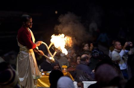 benares: Indian Brahmin conducts religious Ganga Maha Aarti ceremony fire puja at Dashashwamedh Ghat on January 13 2010 in Varanasi Uttar Pradesh India. Editorial