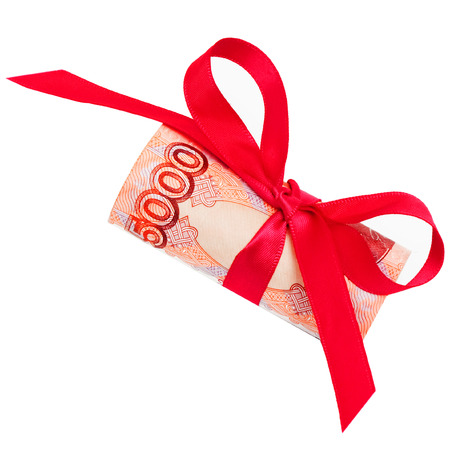 roubles: Concept of discount roubles with red bow isolated on the white background Stock Photo