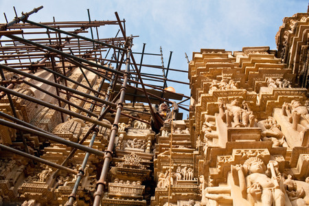 scaffolds: Indian restorer working on the scaffolds at Kandariya Mahadeva Temple on January 17 2010 in Khajuraho India.