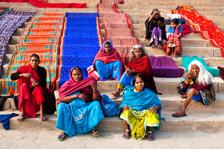 benares: Indian women dry their saris at Dashashwamedh ghat after bathing in the sacred Ganges river on January 15 2010 in Varanasi State of Uttar Pradesh India