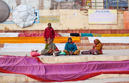 neighbours: Indian women dry their saris at Dashashwamedh ghat after bathing in the sacred Ganges river on January 15 2010 in Varanasi State of Uttar Pradesh India