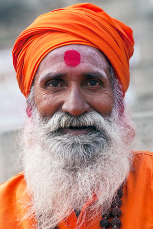 sadhu: Shaiva sadhu holy man seeks alms in front of a temple on January 13 2010 in Varanasi Uttar Pradesh India