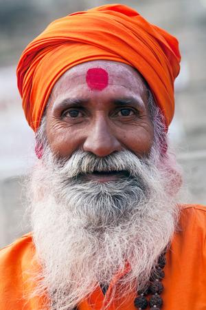 Shaiva sadhu holy man seeks alms in front of a temple on January 13 2010 in Varanasi Uttar Pradesh India