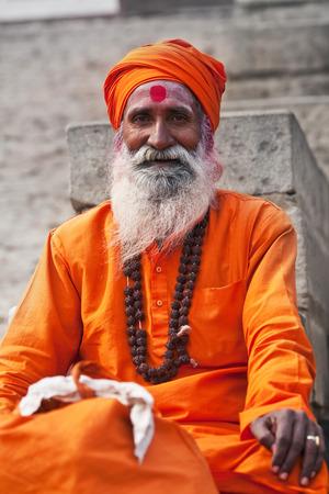 seeks: Shaiva sadhu holy man seeks alms in front of a temple on January 13 2010 in Varanasi Uttar Pradesh India