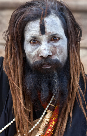 cheater: Indian Aghori sadhu holy man seeks alms in front of a temple on January 13 2010 in Varanasi State of Uttar Pradesh India Editorial