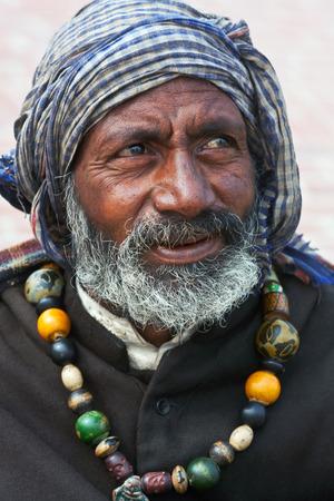 seeks: Street fakir seeks alms at Manikarnika Ghat on January 13 2010 in Varanasi India