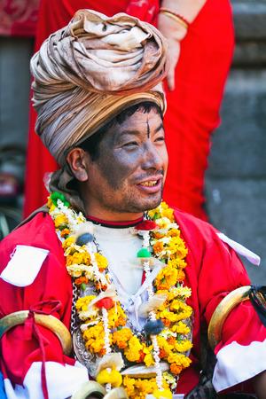 nepali: BHAKTAPUR, NEPAL - APRIL 01: Nepali Shaman poses for a photo during harvest fesival on April 01, 2010 in Bhaktapur, Kathmandu valley, Nepal Editorial