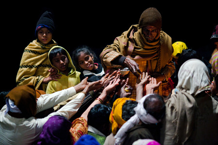 uttar pradesh: VARANASI, UTTAR PRADESH, INDIA  - JANUARY 15: Hindu man offered prasad to poor people after Ganga Maha Aarti ceremony at Dashashwamedh Ghat on January 15, 2010 in Varanasi, India