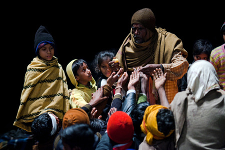 uttar pradesh: VARANASI, UTTAR PRADESH, INDIA  - JANUARY 15, 2010: Hindu man offered prasad to poor people after Ganga Maha Aarti ceremony at Dashashwamedh Ghat in Varanasi, India