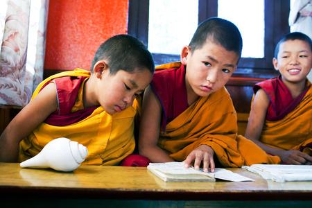 KATHMANDU, NEPAL - NOVEMBER 8: Novice monks learning in Swayambhunath monastery school on November 08, 2009 in Kathmandu, Nepal