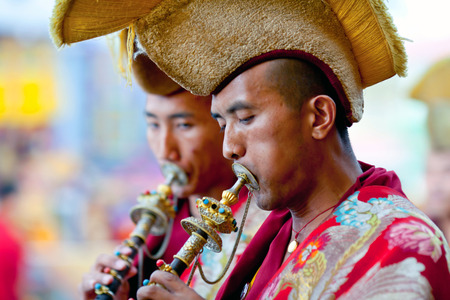 gelugpa: KATHMANDU, NEPAL - MARCH 25: Buddhist monks playing music during Cham mystery at Shechen monastery on March 25, 2010 in Kathmandu, Nepal. Cham is a form of meditation and an offering to the gods.