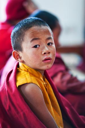 KATHMANDU, NEPAL - JANUARY 06: Tibetan novice monk Dorje Tsering, 8, praying during Puja ceremony in Thrangu Tashi Choling Gompa on January 06, 2010 in Kathmandu, Nepal Redakční