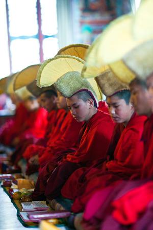gelugpa: KATHMANDU, NEPAL - MARCH 02: Buddhist monks and lamas playing music during Puja ceremony at Shechen monastery on March 02, 2010 in Kathmandu, Nepal Editorial