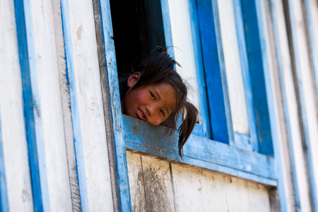 indigence: ANNAPURNA CIRCUIT, NEPAL - APRIL 20: A little tibetian girl from the village of tibetan refugees in the Himalayas, Nepal on 20 April 2008. Editorial