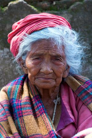 penury: KATHMANDU, NEPAL - MAY 10: Nepalese aged woman seeks alms on the street on May 10, 2008 in Kathmandu, Nepal. Editorial