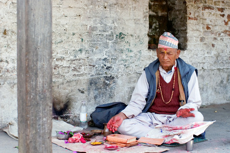 astrologer: Indian Brahman conducts Puja cereminy at Pashupatinath Temple on May 10, 2008 in Kathmandu, Nepal.