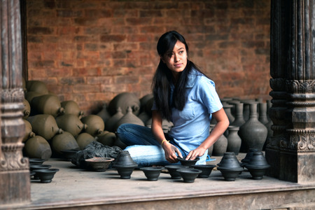 craftswoman: Nepalese craftswoman poses for a photo at work on April 1, 2010 in Bhaktapur, Nepal. Bhaktapur is located about 20 km east of Kathmandu.