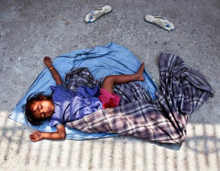 KATHMANDU, NEPAL - APRIL 06: Nepalese boy sleeping on the street on April 6, 2010 in Kathmandu, Nepal.