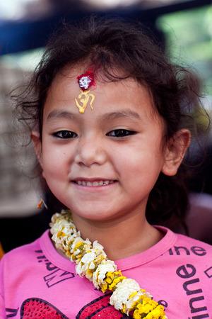 DAKSHINKALI, NEPAL - MAY 11:  Nepalese girl Anuya, 6, carries offering to Dakshinkali Temple on May 11, 2013 in Dakshinkali village, Kathmandu valley, Nepal.